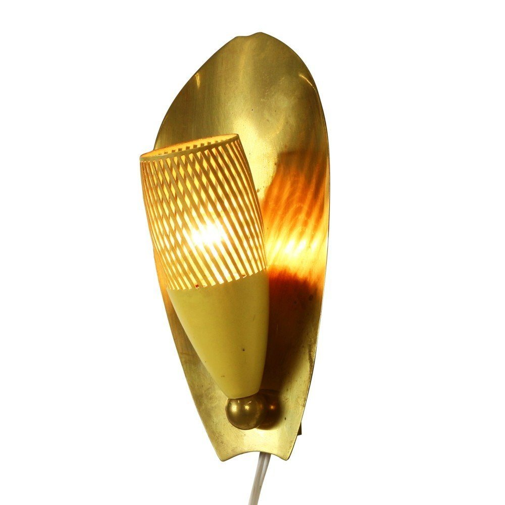 Wall light with a perforated yellow shade and messing backplate, 1950s