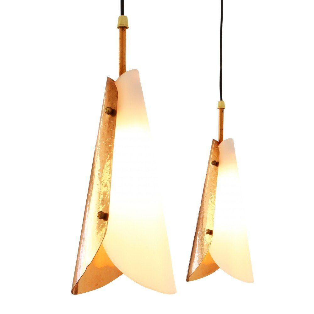 Set of two sophisticated pendant lights made of acrylic and hammered copper, 1950s