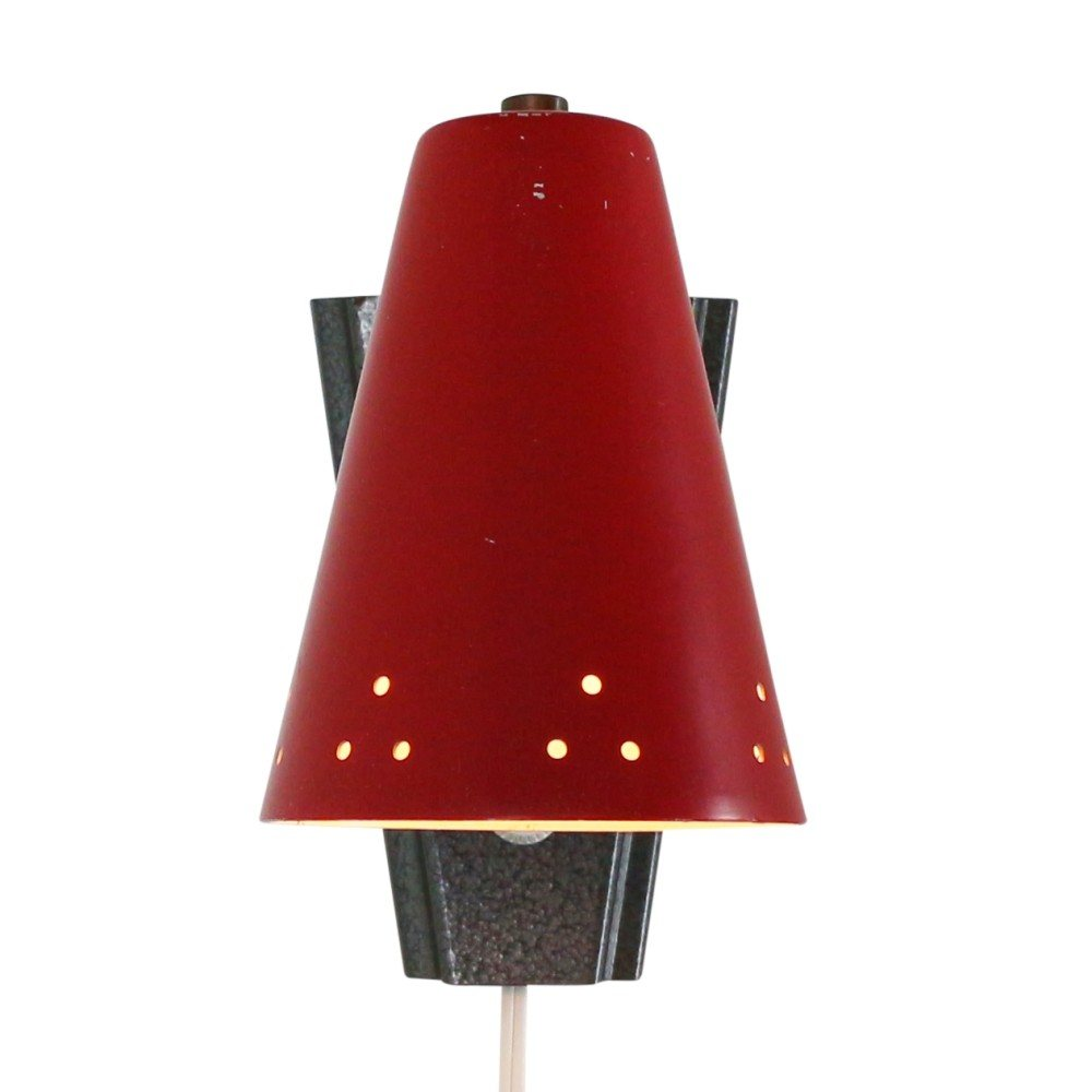 Sixties wall light with perforated red shade
