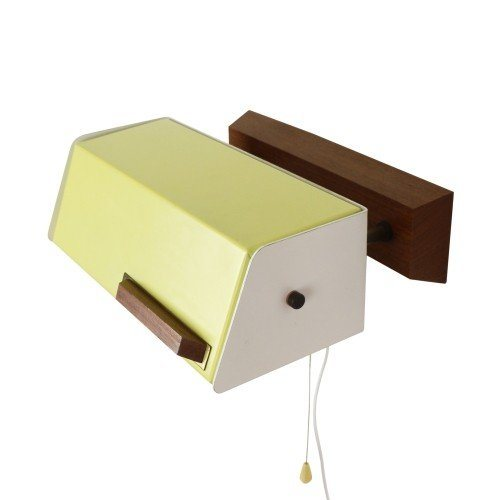 Yellow and white bedside wall light with rotatable shade